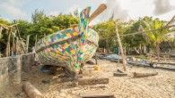 It was 6pm when an unusual rainbow-colored boat, made of recycled plastic waste and discarded flip-flops gathered from beaches and roadsides, dropped anchor off the beach at Mtwapa, near Kenya's...