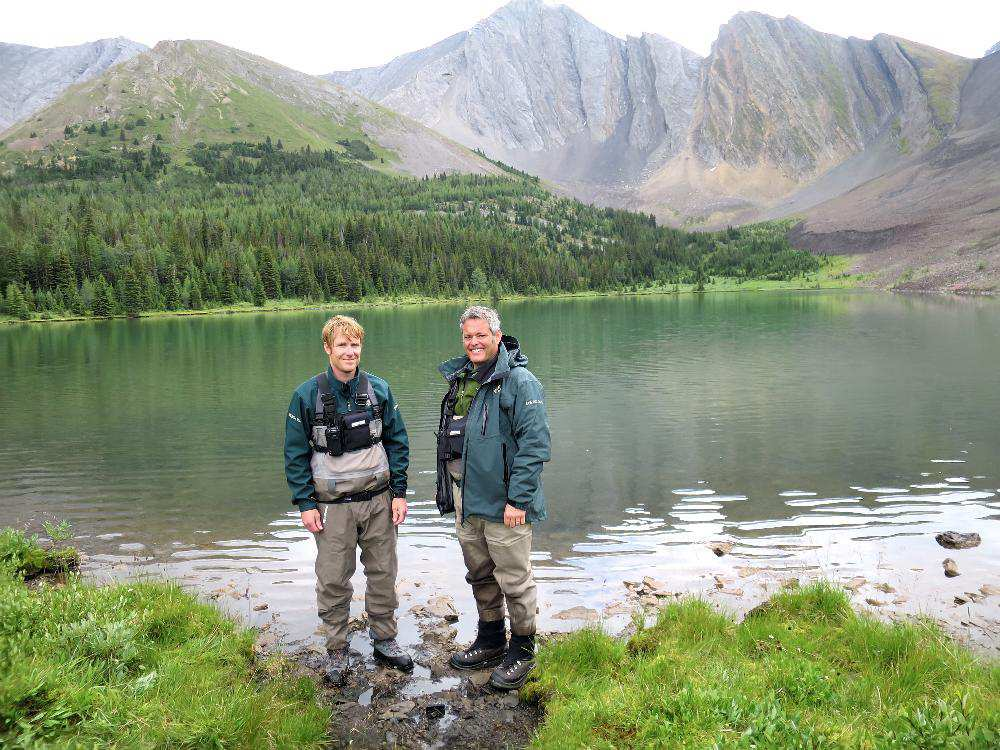 Mark Taylor (left), a Parks Canada's aquatic ecologist and Bill Hunt, resource conservation manager with Banff National Park, stand in front of Rainbow Lake after reintroducing genetically pure westslope cutthroat trout from Sawback