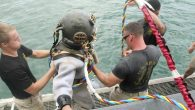 Army 7th Dive Detachment Divers SSG Fred Bible and SPC Julio Melendez wore lead boots and a drysuit — weighing a total of 220 pounds — and the last two Mark 5 vintage hard hats certified for operational use on […]