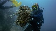 """Underwater divers in plastic-choked waters off the coast of Thailand snip through discarded nets tangled around a reef—a new initiative helping protect marine life and aiding the fight against coronavirus. The """"ghost nets"""" discarded from the country's lucrative fishing industry […]"""